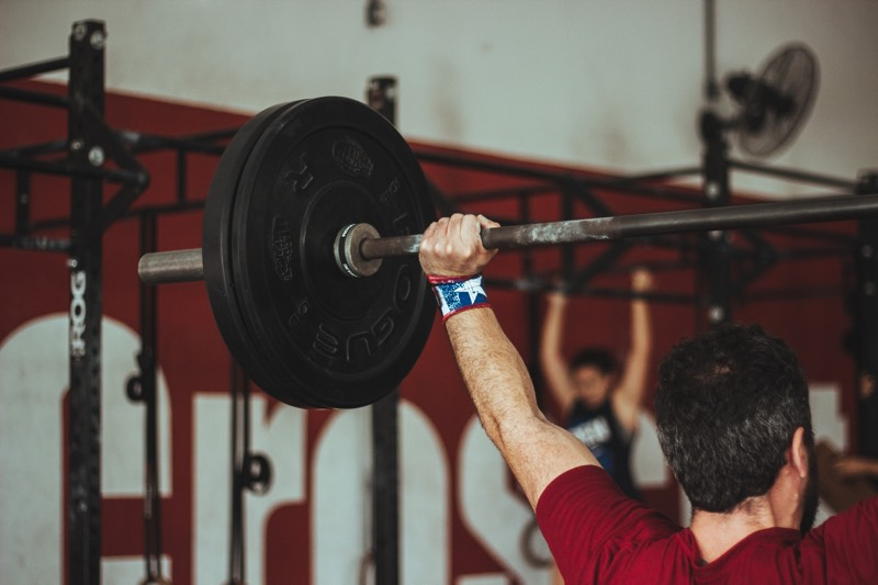 A weightlifter in a CrossFit location